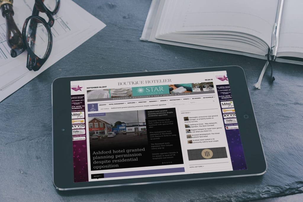 Viewing the Boutique Hotelier blog on a tablet.