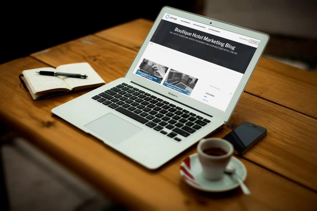 Viewing the Otium Boutique hotel marketing blog on a laptop.